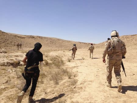 Members of Iraqi security forces are pictured during a patrol looking for militants of the Islamic State on the outskirt Haditha