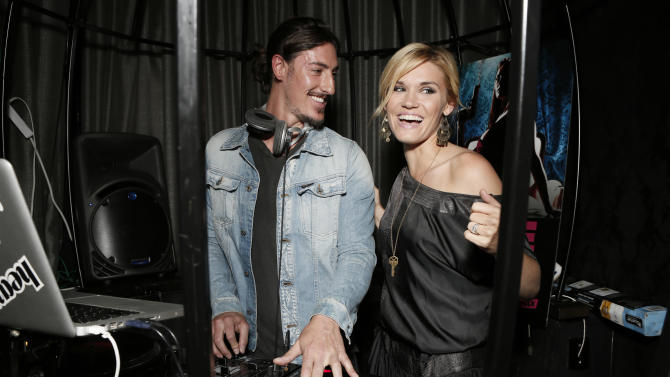 """COMMERCIAL IMAGE:  Eric Balfour, left, DJ's with Emily Rose at the Entertainment One  """"Haven"""" Party at Comic Con 2012 on Thursday, July 12, 2012 in San Diego. (Photo by Todd Williamson/Invision for eOne/AP Images)"""