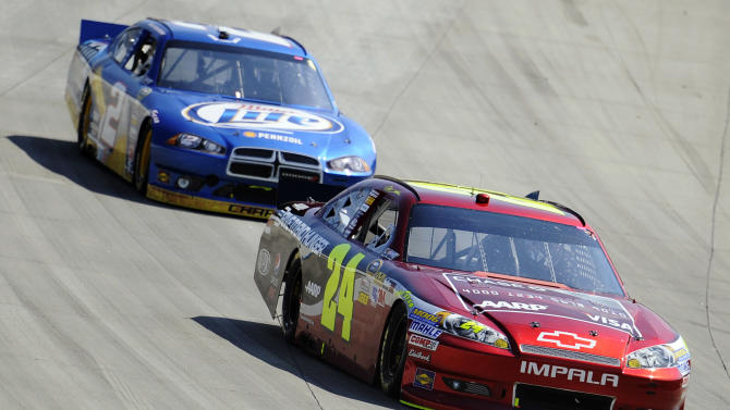 Jeff Gordon, front, and Brad Keselowski, back, compete during a NASCAR Sprint Cup Series auto race, Sunday, Sept. 30, 2012, at Dover International Speedway in Dover, Del. Keselowski went on to win and Gordon finished second. (AP Photo/Nick Wass)