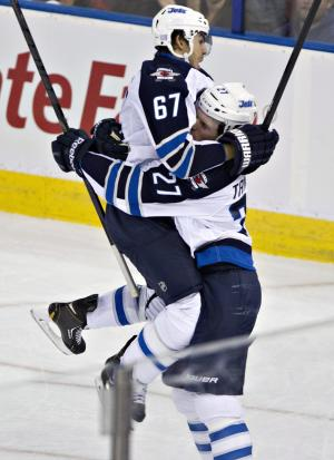 Frolik nets 2, Jets top Oilers in season opener