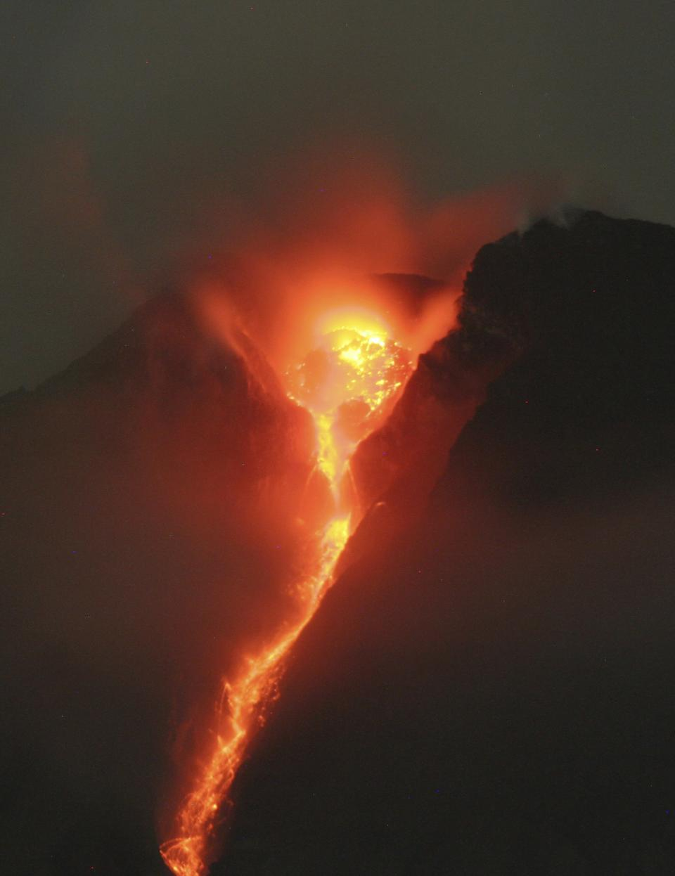 In this late Tuesday, Nov. 2, 2010 photo, lava glows at the crater of Mount Merapi as seen from Deles, Central Java, Indonesia. Indonesia's most dangerous volcano is once again sending searing gas clouds and burning rocks down its scorched flanks. (AP Photo/Binsar Bakkara)