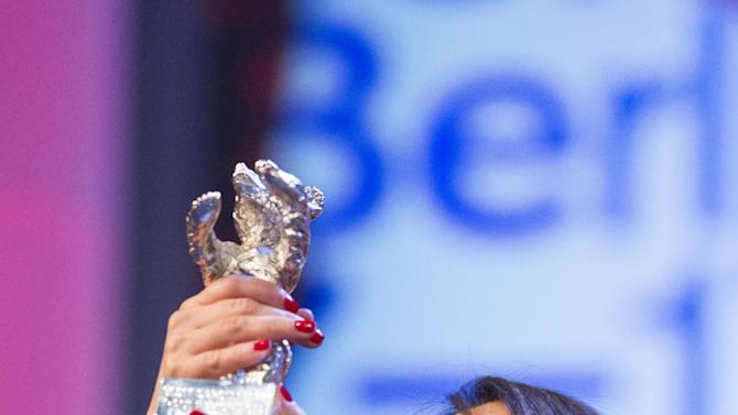 Actress Paulina Garcia with her Silver Bear Best Actress award for her role in Gloria at the closing ceremony at the 63rd edition of the Berlinale, International Film Festival in Berlin, Saturday, Feb. 16, 2013. (AP Photo/Gero Breloer)