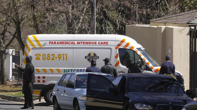 An ambulance transporting former South African president Nelson Mandela arrives at the home of the former statesman in Johannesburg, South Africa, Sunday, Sept. 1, 2013. Mandela has been in hospital for more than two months fighting a recurring lung infection. (AP Photo / Denis Farrell)