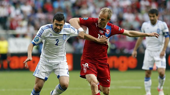 Greece's Yiannis Maniatis, left, and Czech Republic's Daniel Kolar fight for the ball during the Euro 2012 soccer championship Group A match between Greece and Czech Republic in Wroclaw, Poland, Tuesday, June 12, 2012. (AP Photo/Antonio Calanni)