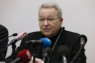 Paris&#39; Archbishop Andre Vingt-Trois speaks during a press conference on February 11, 2013 in Paris. Putting the blame for paedophilia on the Roman Catholic Church is a way of avoiding the issue, Vingt-Trois says