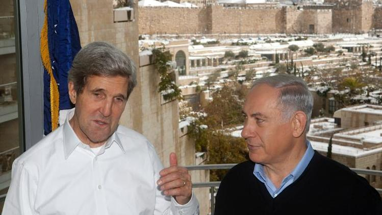 Israeli Prime Minister Benjamin Netanyahu (right) listens to US Secretary of State John Kerry in Jerusalem, on December 13, 2013