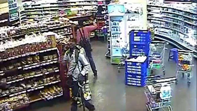 In this photo taken from footage from Citizen TV, via the Kenya Defence Forces and made available Friday, Oct. 4 2013, a man reported to be Khatab Alkene, one of the four armed militants walking in a store at the Westgate Mall, during the four-day-long siege at the Westgate Mall in Nairobi, Kenya which killed more than 60 people last month. A Kenyan military spokesman has confirmed the names of four attackers as Abu Baara al-Sudani, Omar Nabhan, Khattab al-Kene and Umayr. (AP Photo/ Kenyan Defence forces via Citizen TV)