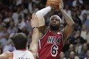 Portland Trail Blazers&#039; Pavlovic defends as Miami Heat&#039;s James shoots in the first half of their NBA basketball game in Miami, Florida