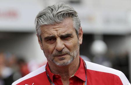 Ferrari Formula One team principal Arrivabene walks in the pit at the end of the first free practice session at the Monaco F1 Grand Prix