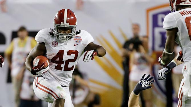 Alabama's Eddie Lacy (42) runs past Notre Dame's Danny Spond (13) during the first half of the BCS National Championship college football game Monday, Jan. 7, 2013, in Miami. (AP Photo/David J. Phillip)