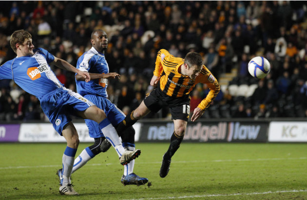 Hull City's Nick Barmby, right, scores his second goal against Wigan Athletic during their English FA Cup third round soccer match at the KC Stadium, Hull, England, Saturday Jan. 8, 2011. (AP Photo/Jo