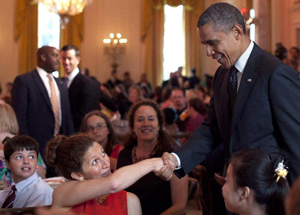"President Barack Obama shakes hands during the Kids' ""State Dinner,""  hosted by first lady Michelle Obama, Monday, Aug. 20, 2012, in the East Room of the White House in Washington (AP Photo/Carolyn Kaster)"