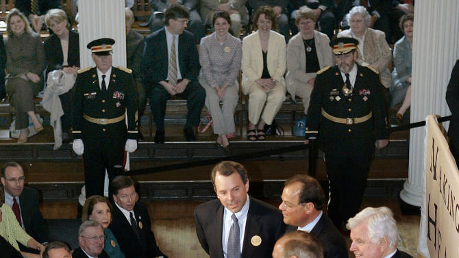 FILE -  in this April 12, 2006 file photo, Massachusetts Gov. Mitt Romney, seated, smiles with clockwise from top state Health and Human Services Secretary Timothy Murphy; state Senate President Robert Travaglini; Sen. Edward Kennedy, D-Mass.; and state House Speaker Salvatore DiMasi at Faneuil Hall in Boston. Romney signed into law a bill designed to guarantee virtually all state residents have health insurance.  The Massachusetts law provides a model for the rest of the nation as states work to establish their own health exchanges in 2013.   (AP Photo/Elise Amendola, File)