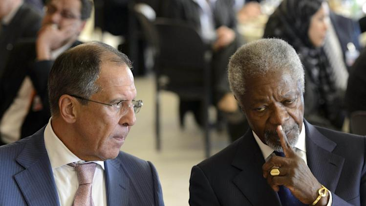 Kofi Annan, right, Joint Special Envoy of the United Nations and the Arab League for Syria, speaks with Russian Foreign Minister Sergey Lavrov, before a dinner hosted by Swiss authorities after a meeting of the Action Group for Syria at the European headquarters of the United Nations, in Geneva, Switzerland, Saturday, June 30, 2012. (AP Photo/Laurent Gillieron, Pool)