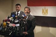 Muslim Brotherhood Egyptian presidential candidate Mohammed Mursi (R) gives a press conference in Cairo. The Muslim Brotherhood today urged Egyptians to rally behind their presidential candidate in an almost certain run-off with rival Ahmed Shafiq, warning the country would be in danger if fallen dictator Hosni Mubarak&#39;s premier wins