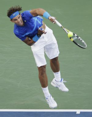 Rafael Nadal of Spain serves to Andy Roddick during a quarterfinal match at the U.S. Open tennis tournament in New York, Friday, Sept. 9, 2011. (AP Photo/Charlie Riedel)
