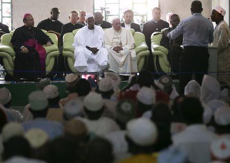 Pope Francis sits next to Tidiani Moussa Naibi Imam of the Koudoukou Mosque in Bangui, Central African Republic