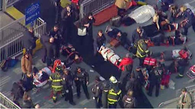 This aerial photo provided by WABC News Channel 7 shows emergency personnel at the scene of a ferry crash in Lower Manhattan, Wednesday, Jan. 9, 2013, in New York. The Fire Department says at least 50