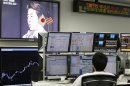 Asia stocks eke out gains on China hopes, oil eases