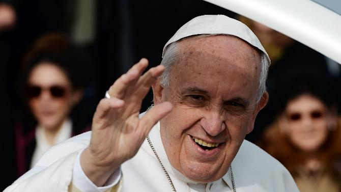 Pope Francis as he greets the crowd in the Scampia district of Naples, Italy, March 21, 2015