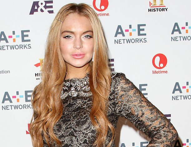 In this May 9, 2012 photo shows actress Lindsay Lohan at the A&E Networks 2012 Upfront at Lincoln Center in New York. Lohan will star as Elizabeth Taylor in the upcoming Lifetime TV movie &quot;Liz & Dick.&quot; Police in Santa Monica, Calif., say Lohan was involved in a car accident on Pacific Coast Highway around 11:45 a.m. Friday and that an investigation is ongoing. (AP Photo/Starpix, Kristina Bumphrey, file)