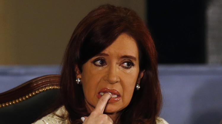 Argentina's President Cristina Fernandez de Kirchner gestures as she attends a ceremony at Buenos Aires' Stock Exchange