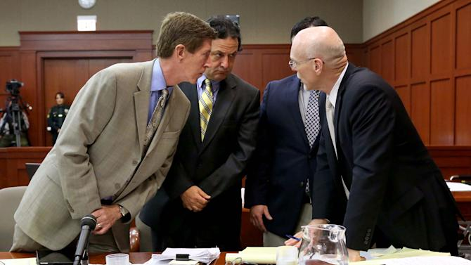 George Zimmerman, obscured, confers with defense attorney Mark O'Mara, left, jury consultant Robert Hirschhorn, second from left, and co-counsel Don West, right, during Zimmerman's trial in Seminole circuit court in Sanford, Fla., Tuesday, June 18, 2013. Zimmerman has been charged with second-degree murder for the 2012 shooting death of Trayvon Martin.(AP Photo/Orlando Sentinel, Joe Burbank, Pool)