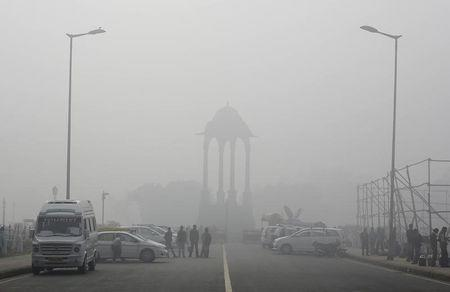 Choking Delhi vows pollution tax, car-free days to improve air