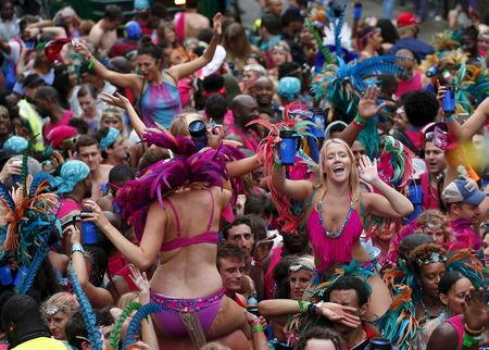 Revellers dance at the Notting Hill Carnival in west London