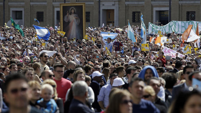 Faithful cheer at Pope Francis as he appears from his studio's window to deliver the Regina Coeli prayer, in St. Peter's Square at the Vatican, Sunday, April 7, 2013. (AP Photo/Gregorio Borgia)