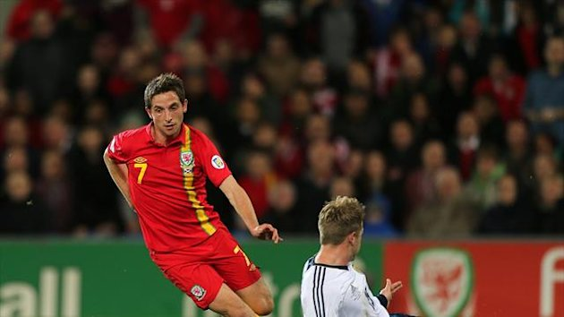 Joe Allen, left, is set to feature in Wales' forthcoming World Cup qualifiers
