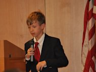 "Robert (""Bobby"") Paul, 13-year-old grandson of Ron Paul and son of Rand Paul, addresses caucus voters in Clive, Iowa, on behalf of his grandfather on January 3, 2012."
