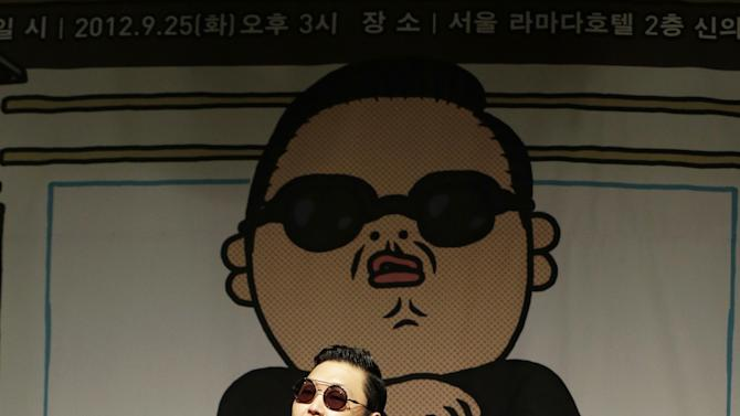 """In this Sept. 25, 2012 photo, South Korean rapper PSY, who sings the popular """"Gangnam Style"""" song, performs during a press conference in Seoul, South Korea. As """"Gangnam Style"""" gallops toward 1 billion views on YouTube, the first Asian pop artist to capture a massive global audience has gotten richer click by click. So too has his agent and his grandmother. But the money from music sales isn't flowing in from the rapper's homeland South Korea or elsewhere in Asia. With one song, 34-year-old Park Jae-sang — better known as PSY — is set to become a millionaire from YouTube ads and iTunes downloads, underlining a shift in how money is being made in the music business. (AP Photo/Lee Jin-man)"""