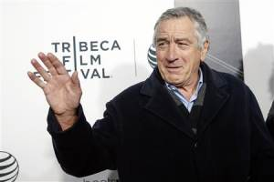 Robert De Niro waves upon arriving for the 2014 Tribeca Film Festival opening night screening of 'Time Is Illmatic' in New York