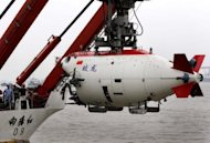 The manned Chinese submersible 'Jiaolong' has broken through the 7,000-metre mark for a new national deep water dive record, as the Asian giant showed off its technological might. (AFP Photo/)