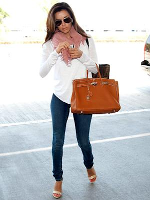 Eva Longoria Catches Flight in $12,000 Outfit
