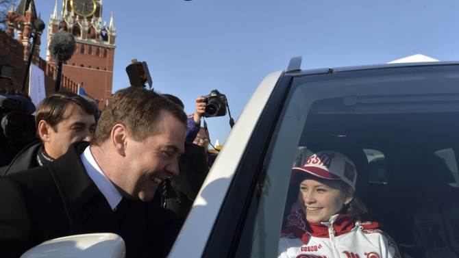 Russia's Prime Minister Medvedev and figure skating gold medal winner Lipnitskaya attend ceremony to present automobiles to the Sochi 2014 Winter Olympics prize-holders representing Russia, in central Moscow