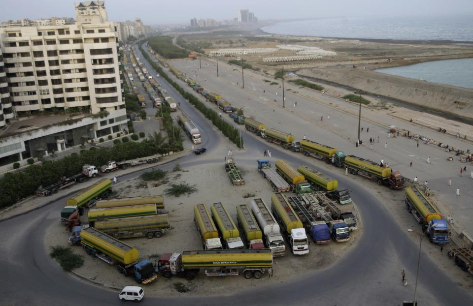 Oil tankers, which were used to transport NATO fuel supplies to Afghanistan, are parked, in Karachi, Pakistan, Monday, July 2, 2012. (AP Photo/Shakil Adil)