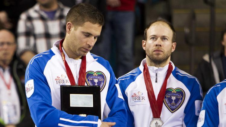 Team British Columbia skip Morris and Cotter are pictured after losing the final draw against team Alberta at the 2014 Tim Hortons Brier curling championships against team British Columbia in Kamloops.