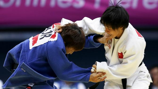 China's Wu Shugen competes with South Korea's Jeong Bok-yeong during their women's -48kg bronze medal judo match during the 17th Asian Games in Incheon