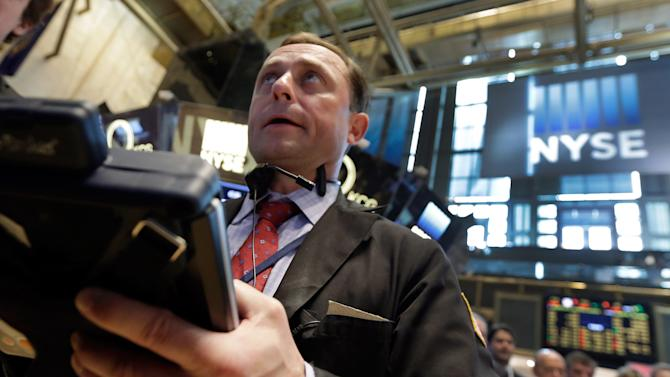 Trader George Baskinger works on the floor of the New York Stock Exchange, Tuesday, May 26, 2015. Stocks are opening lower on Wall Street as traders return from the Memorial Day holiday in the U.S.(AP Photo/Richard Drew)