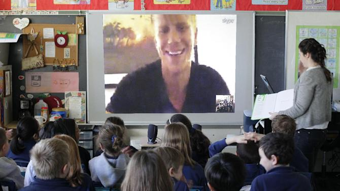 "IMAGE DISTRIBUTED FOR SKYPE - In this image released on Tuesday, April 2, 2013, Sean Lowe steps away from the ballroom to read ""The Giving Tree"" via Skype to a class of third graders at St. Paul School in Princeton, N.J.  The session is a part of Skype in the classroom's Read Aloud Initiative where Skype secured commitments from over 30 influential celebrities and business leaders to read aloud to a classroom using Skype before the end of the 2012/2013 school year.   (Tom Mihalek/AP Images for Skype)"