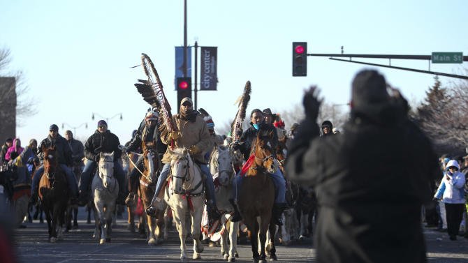 "The Dakota Wokiksuye Memorial Ride staff keeper Peter Lengkeek, of Crow Creek, S.D., center left, and Richard Milda, of Crow Agency, Mont, center right, led the riders into Reconciliation Park Wednesday, Dec. 26, 2012, in Mankato, Minn. The annual ride commemorates the 38 + 2 Dakota warriors hanged following the Dakota War of 1862. The ""Dakota 38"" Memorial lists the names of all the Dakota warriors hanged in 1862. (AP Photo/The Star Tribune, David Joles)"