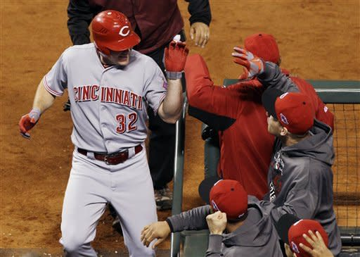 Reds lose ace, win first playoff game in 17 years