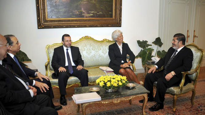 In this image released by the office of the Egyptian Presidency, International Monetary Fund Chief Christine Lagarde, second right, meets with Egyptian President Mohammed Morsi, right, in Cairo, Egypt, Wednesday, Aug. 22, 2012. Egypt's prime minister says his country has formally asked the International Monetary Fund for a $4.8 billion loan to help boost its battered economy, and that he expects to reach a deal by the end of the year. (AP Photo/Egyptian Presidency)