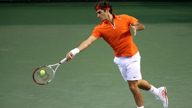 UNITED STATES, INDIAN WELLS : INDIAN WELLS, CA - MARCH 13: Roger Federer of Switzerland hits a return to Stanislas Wawrinka of Switzerland during day 8 of the BNP Paribas Open at Indian Wells Tennis Garden on March 13, 2013 in Indian Wells (AFP)