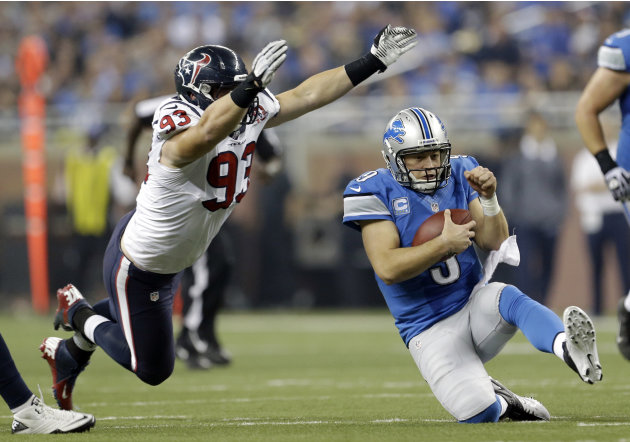 Detroit Lions quarterback Matthew Stafford (9) slides after scrambling away from Houston Texans defensive end Jared Crick (93) during the fourth quarter of an NFL football game at Ford Field in Detroi