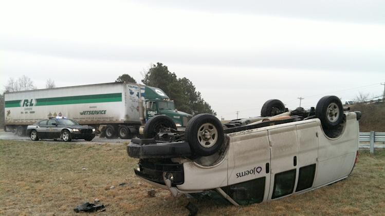 Overturned vehicle on I40 westbound at Oxford School Road in Catawba County. The National Weather Service has issued a winter weather advisory for most of the state until late Friday night or early Saturday. (AP Photo/The Charlotte Observer, Jeff Willhelm) MAGS OUT; TV OUT; NEWSPAPER INTERNET ONLY
