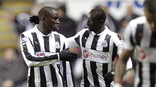 Demba Ba celebrates with Papiss Cisse after Newcastle United's first goal against Wigan Athletic (AFP)