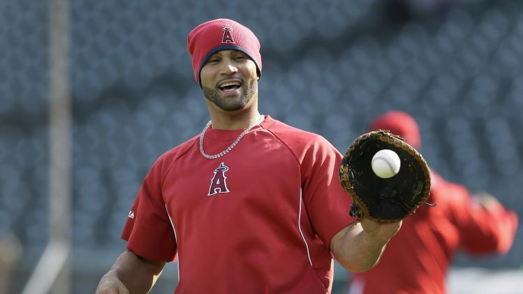 Los Angeles Angels first baseman Albert Pujols warms up before a baseball game against the Detroit Tigers in Detroit, Friday, April 18, 2014. (AP Photo/Carlos Osorio)